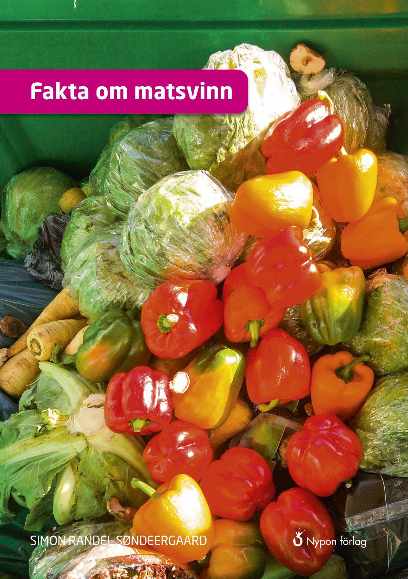 Ätbara grönsaker som är slängda i en soptunna.